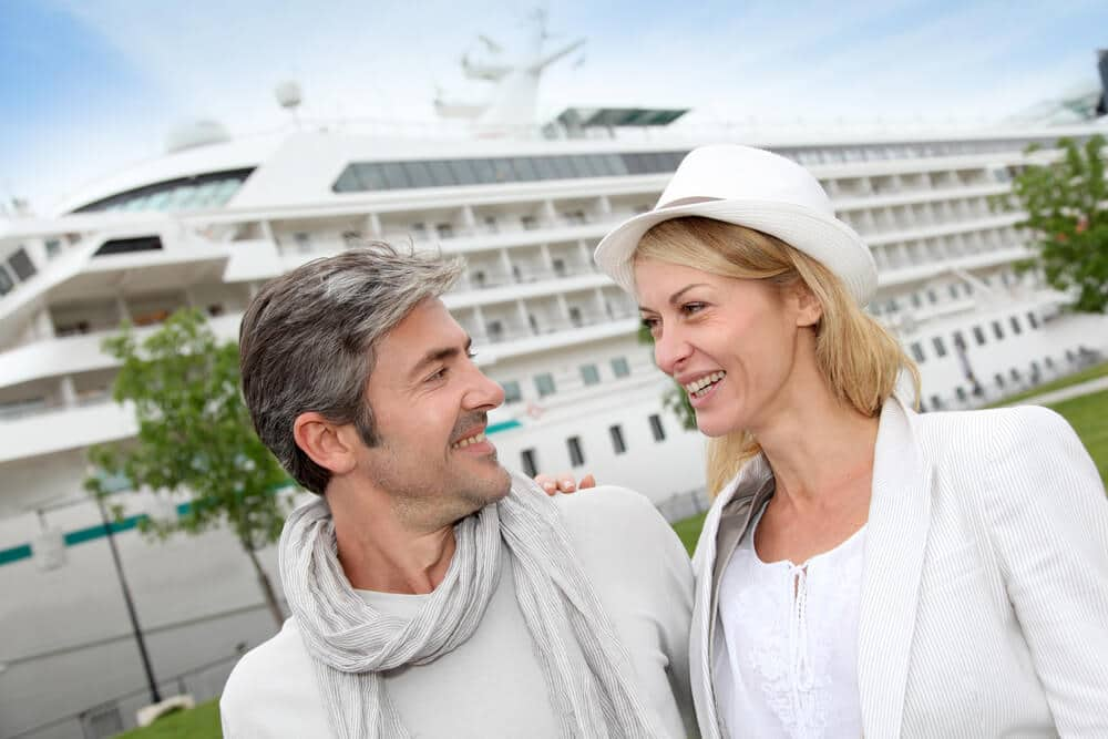 senior couple getting ready to board a cruise ship for an adventurous vacation
