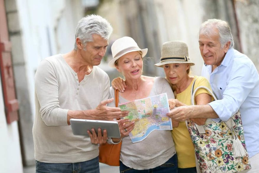 seniors touring europe and looking at a map