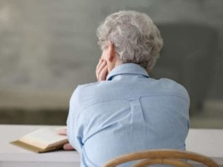 view of a depressed elderly woman from behind
