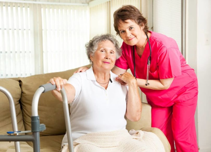 live in caregiver checking on a senior woman's health