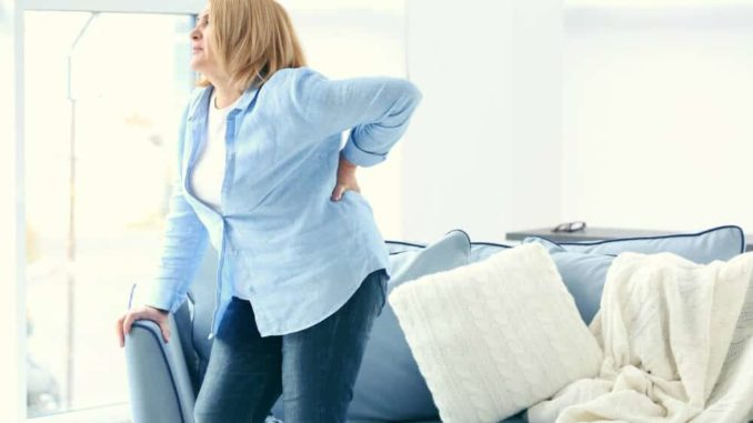 senior woman with sciatica back pain