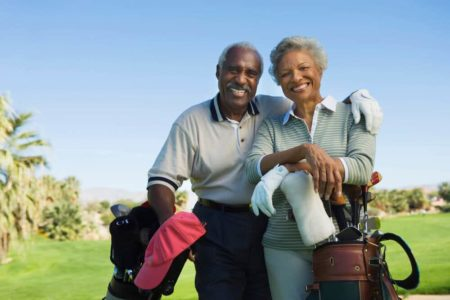 senior couple playing golf together