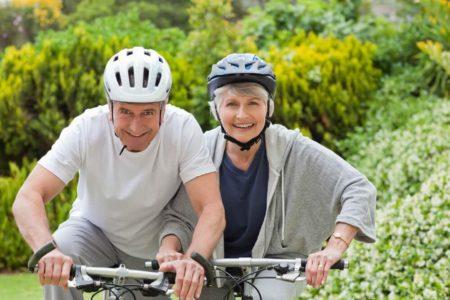 senior couple riding their bicycles