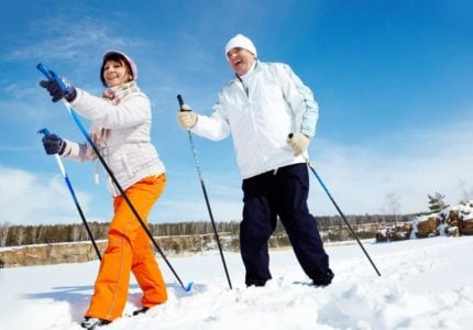 senior couple enjoying some cross country skiing