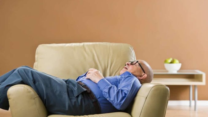 senior man sleeping in a chair