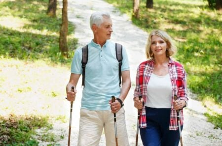 senior couple on a nordic walk with walking sticks