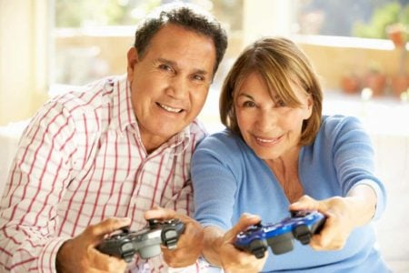 senior couple playing video games
