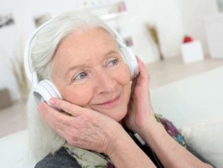 woman wearing the best TV headphones for seniors