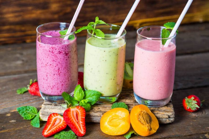 various fruit smoothies in glass cups