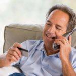 senior man using a large button cordless phone