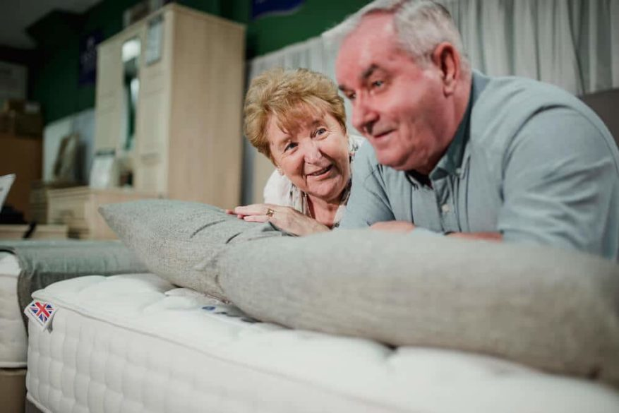 senior couple shopping for a new mattress