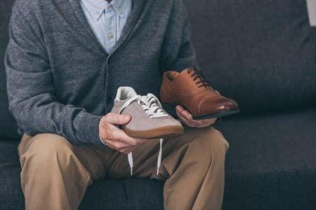 senior man choosing a new pair of orthopedic shoes