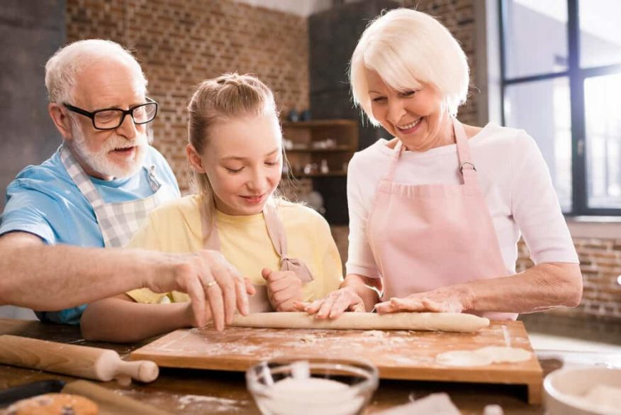 granddaughter baking with her grandparents