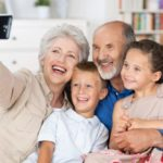grandparents taking photo with grandkids