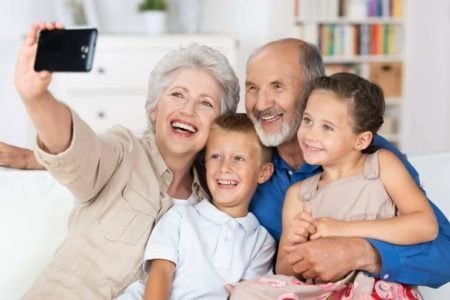 grandparents taking photo with grandkids