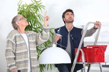 senior woman needing help with home repair
