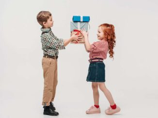 grandkids sharing a gift