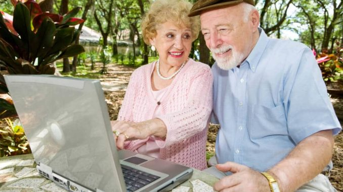 senior couple using a laptop and checking their email