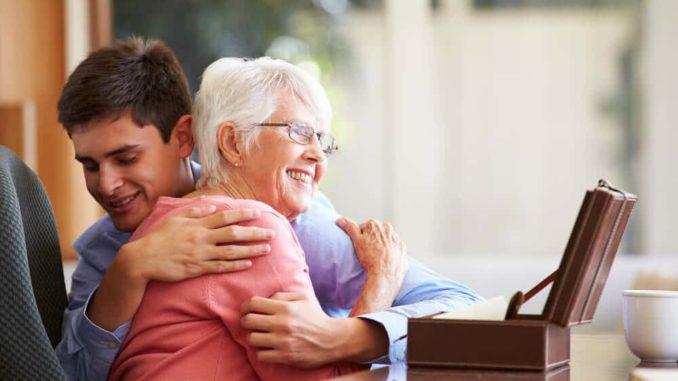 grandmother hugging her teenage grandson