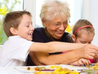grandmother doing activities with grandkids inside house in winter