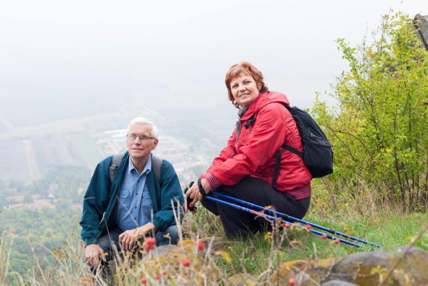 senior couple hiking and taking a break