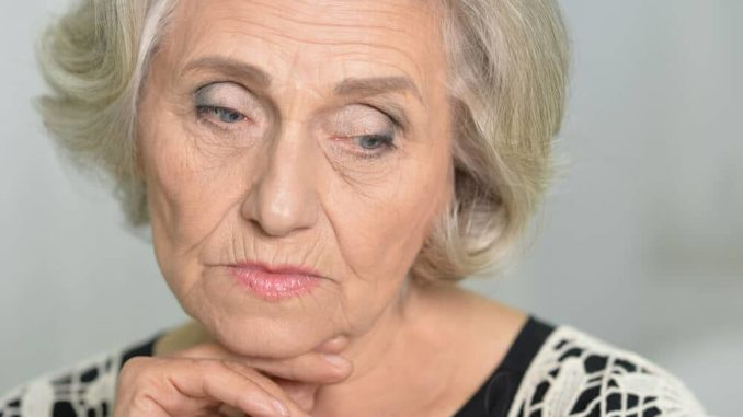 senior woman frowning thinking about her incontinence