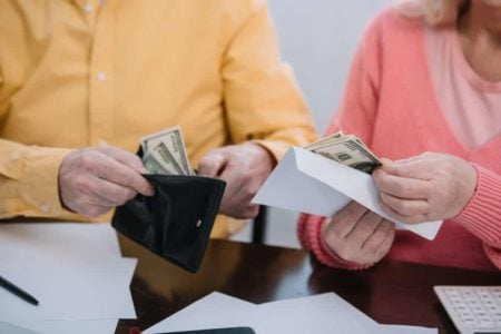 senior couple with wallets for arthritic hands