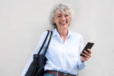 senior woman smiling with the best purse for fibromyalgia