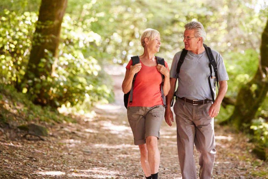 senior couple enjoying a walk in nature