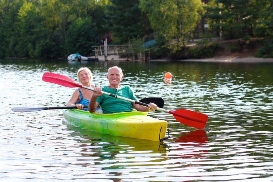seniors paddling a kayak on the lake
