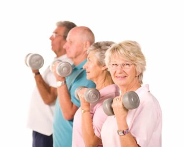 seniors in their 70's lifting weights for better health