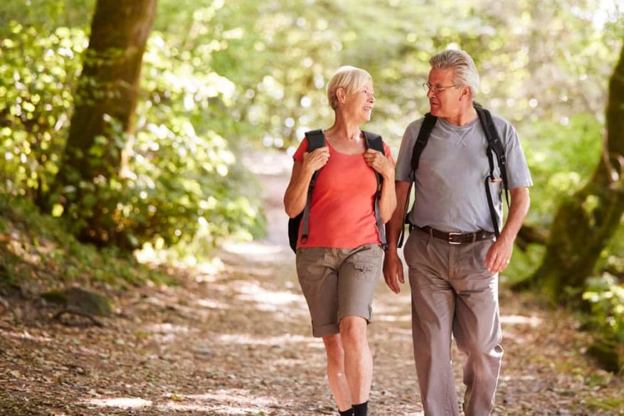 senior couple talking while on a hike together