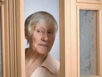 woman with dementia trying to open door