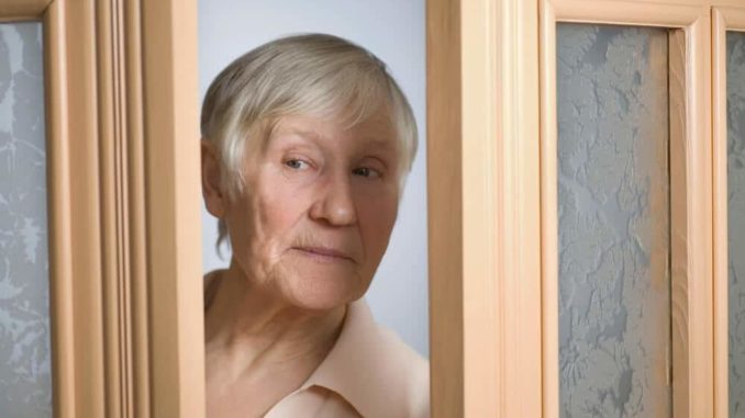 woman with dementia trying to open door