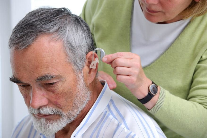 man getting fit for a hearing aid