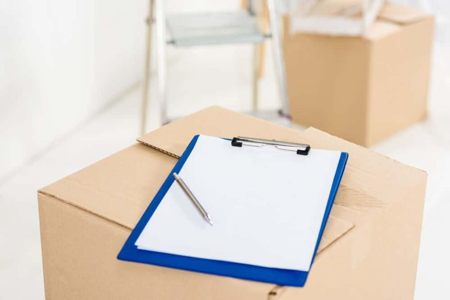 clipboard with checklist on a moving box
