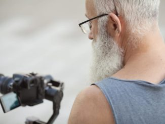 senior man using camera to take photos