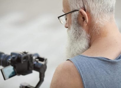 senior man using camera to take photos