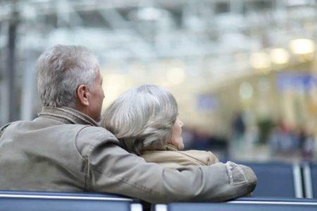 senior citizens sitting in airport waiting area
