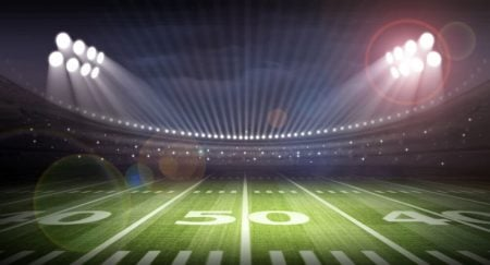 football stadium at nights with lights on