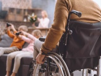 man moving wheelchair in his accessible home