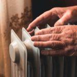older man using a safe heater for seniors