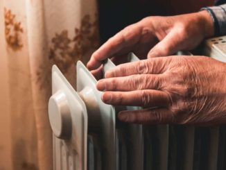 older man using a safe heater for seniors
