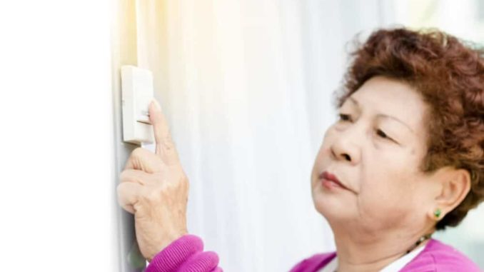 senior woman testing out her new senior friendly doorbell