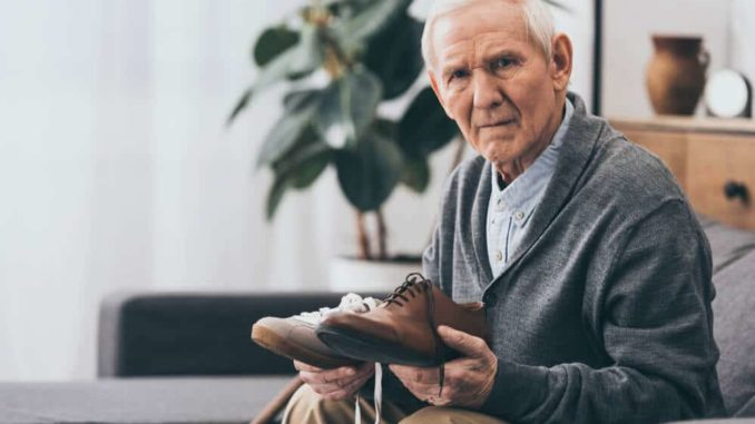 senior man with shuffling gait for shopping for shoes