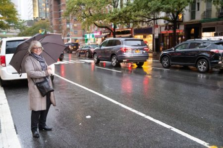 senior woman waiting for a ride share car