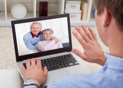 senior couple talking to doctor on tablet