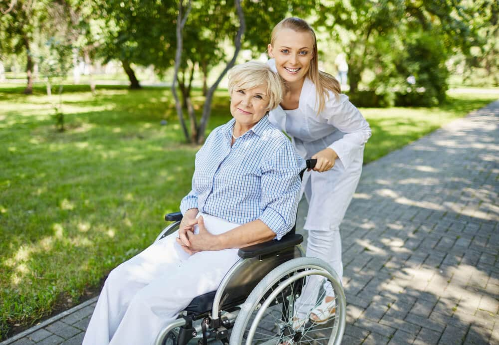 smiling senior woman using the best wheelchair for her needs