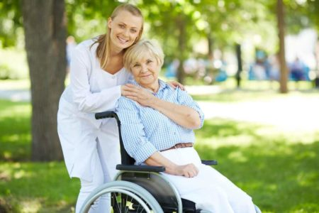 woman smiling while sitting in her comfortable manual wheelchair