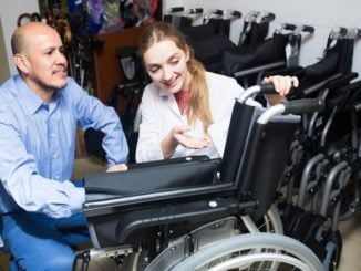 woman showing a man the different types of wheelchairs